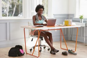Young black woman CEO using computer
